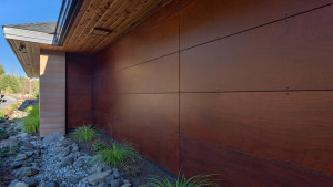 Between rammed earth walls there are 'rainscreen' walls featuring maintenance free resin wood panels.