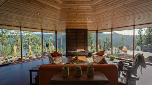 The owners requested a panoramic view of the lake and mountains, interrupted only by the hearth.