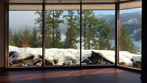 In the deepest cold of winter, these high performance curtain walls of glass are totally comfortable to sit next to.  You can see the snow also feeling comfy right next to the glass.