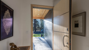 Passive house doors and windows are exceptional for their quality and performance.  This custom door, built for us inj Germany, has accents of steel that tie visually to the pattern of the exterior walls.