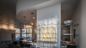 The dining room windows are glazed with art glass to provide visual privacy without blocking light, creating beautiful  interior illumination patterns.