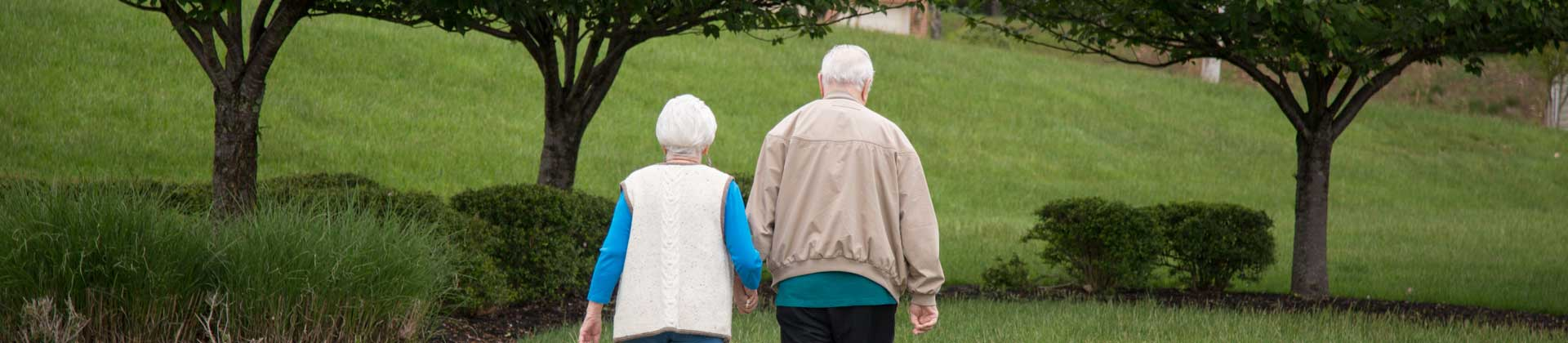 A couple of seniors walking outside