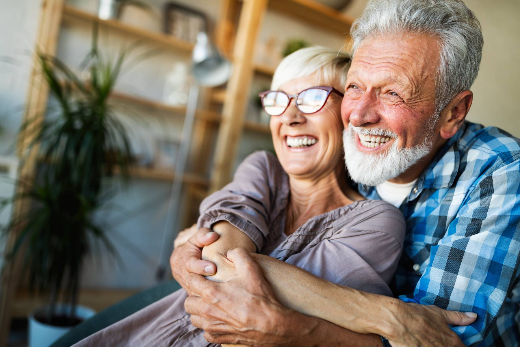 senior couple hugging and smiling together