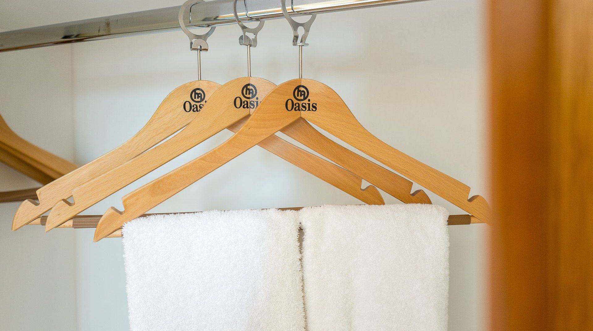 The hangers of our rooms with our logo
