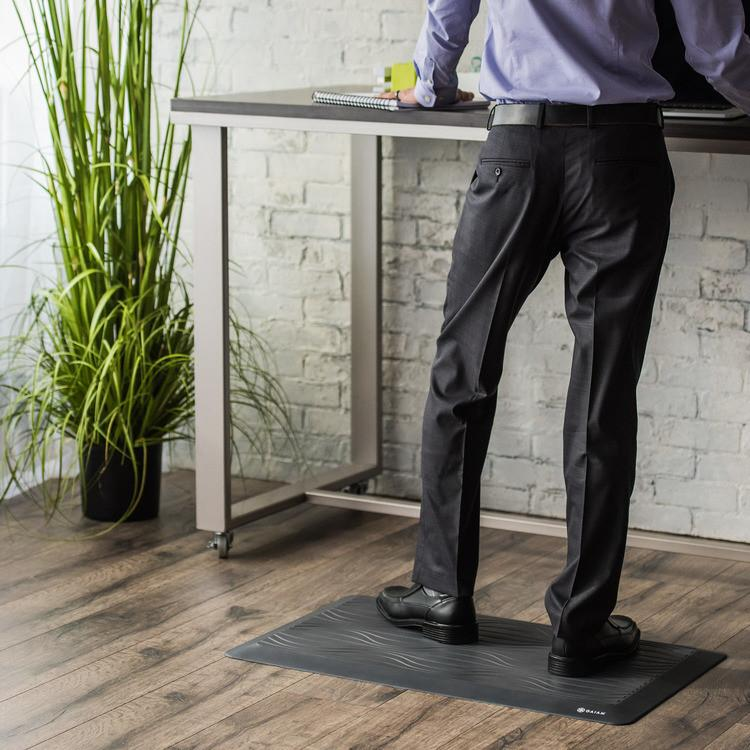 Man standing on anti fatigue mat