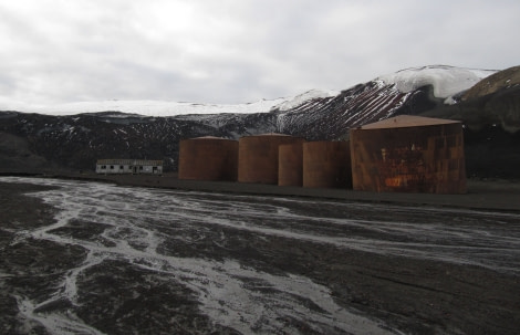 Rusty old whale oil tanks in Whalers Bay, Deception Island