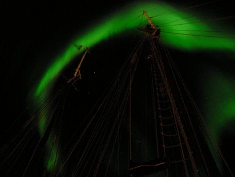 s/v Noorderlicht underneath the Aurora Borealis