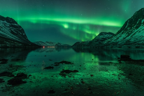 North Norway, Aurora Borealis reflecting on water and ice