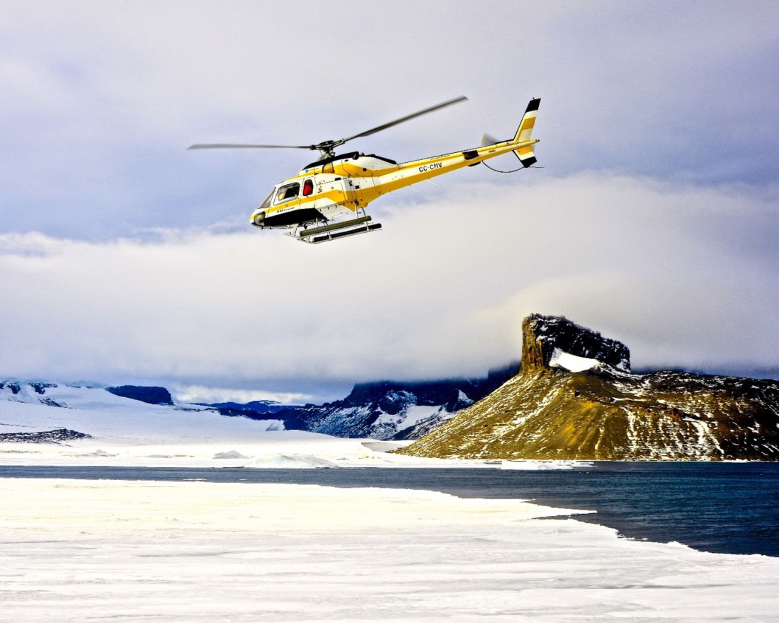 Helicopter flight above the Weddell Sea in Antarctica