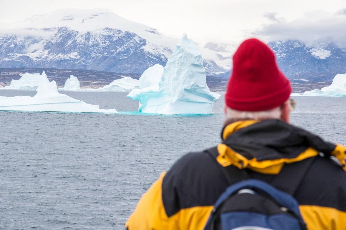 Passenger enjoying the icebergs of Scoresbysund