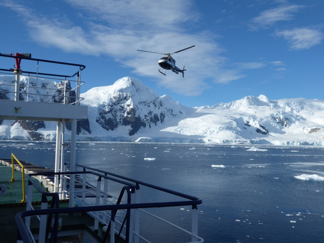 Helicopter approaching the ship in the Ross Sea