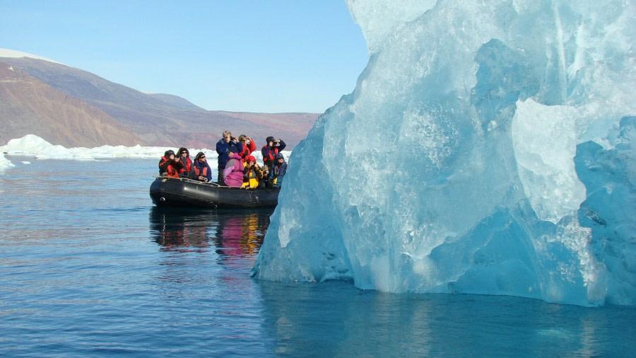 Zodiac cruising among massive icebergs