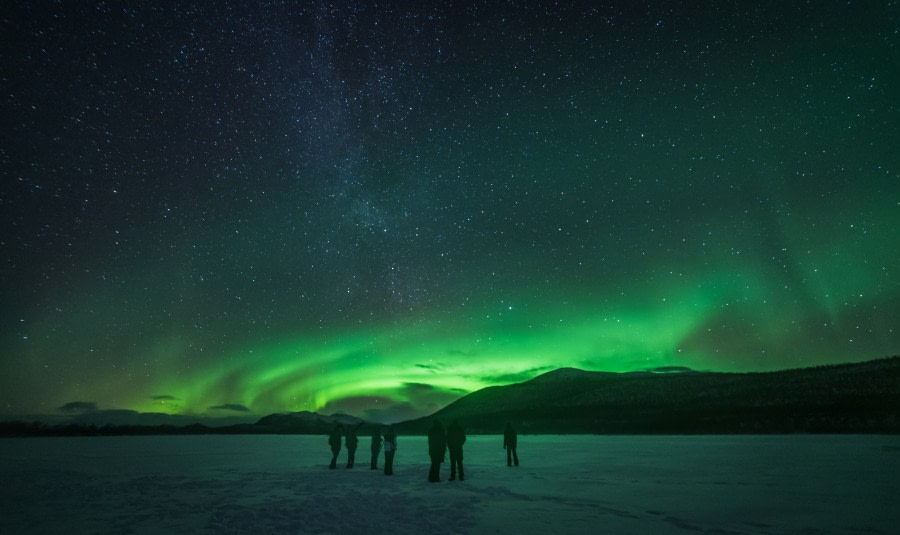 North Norway, Aurora Borealis and Milky Way over a frozen lake