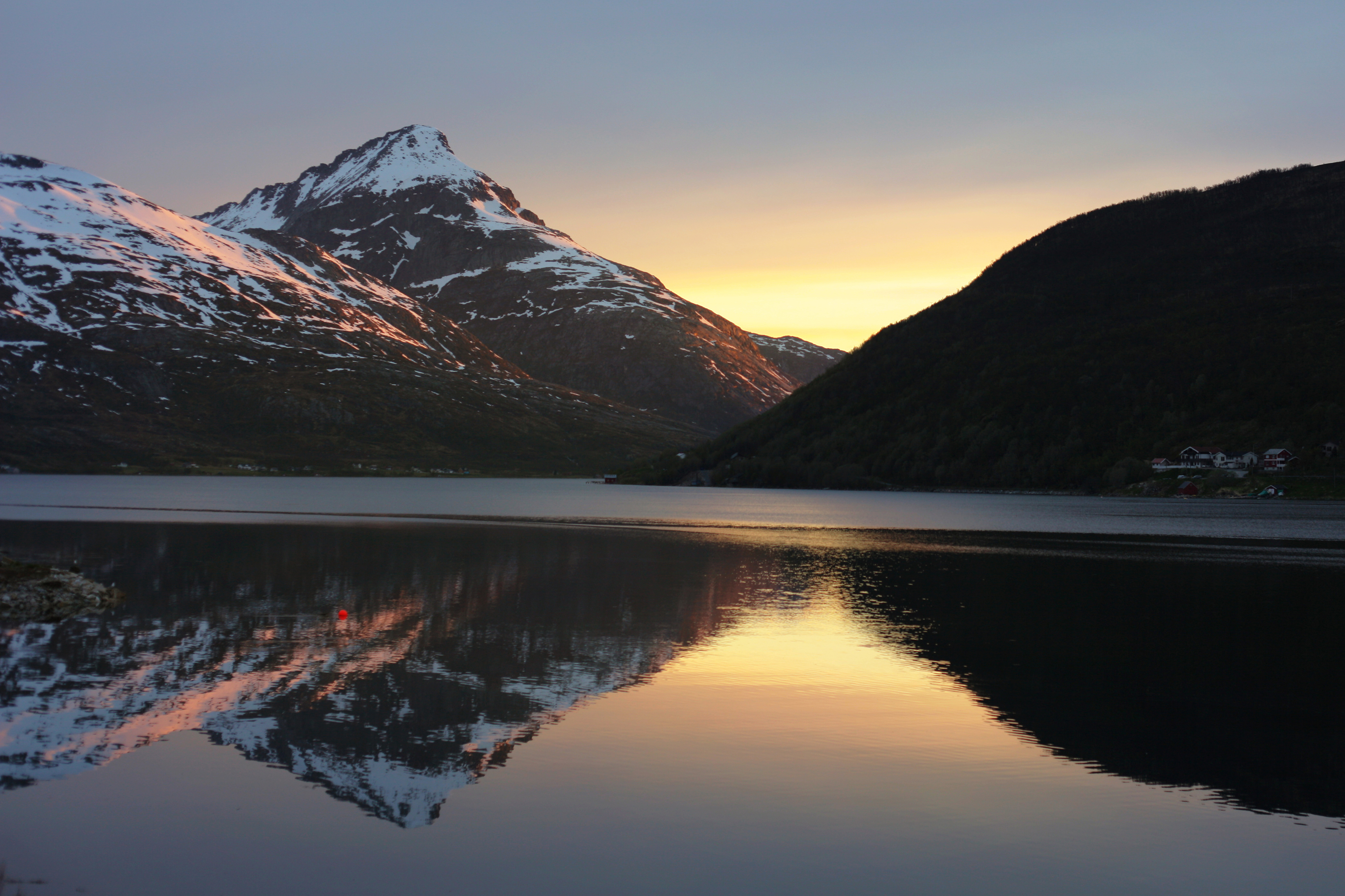 Reflection of Store Blamann - the highest peak from the island of Kvaloya in North Norway