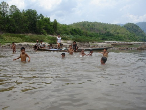 Little children swimming in the Nam Ou river (on the way