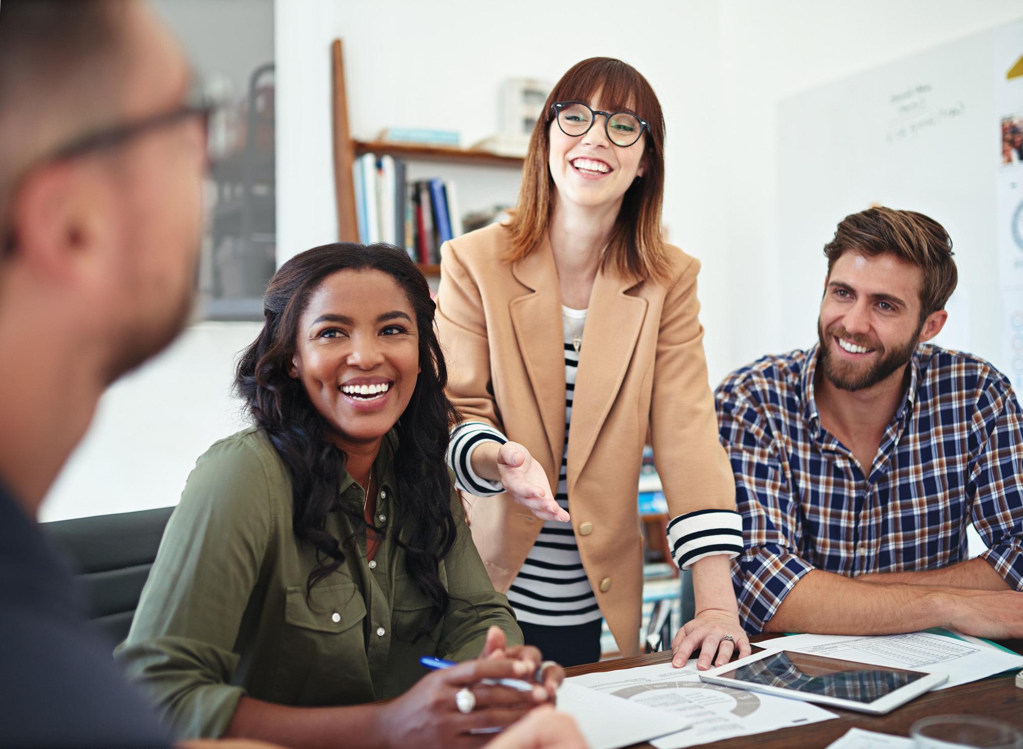 Coworkers in an office talking</figure></div></body></html>