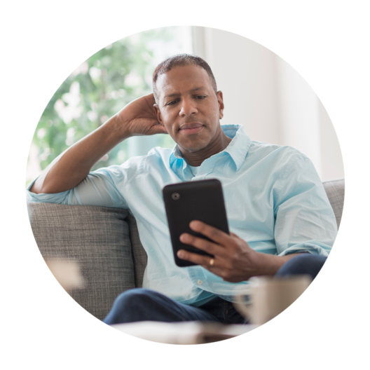 Man Holding Phone On Couch Circle 1056x1056