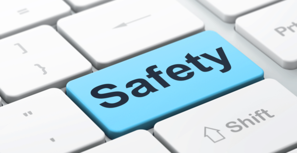 """Close up of computer keyboard with the largest key's text changed to """"safety"""""""
