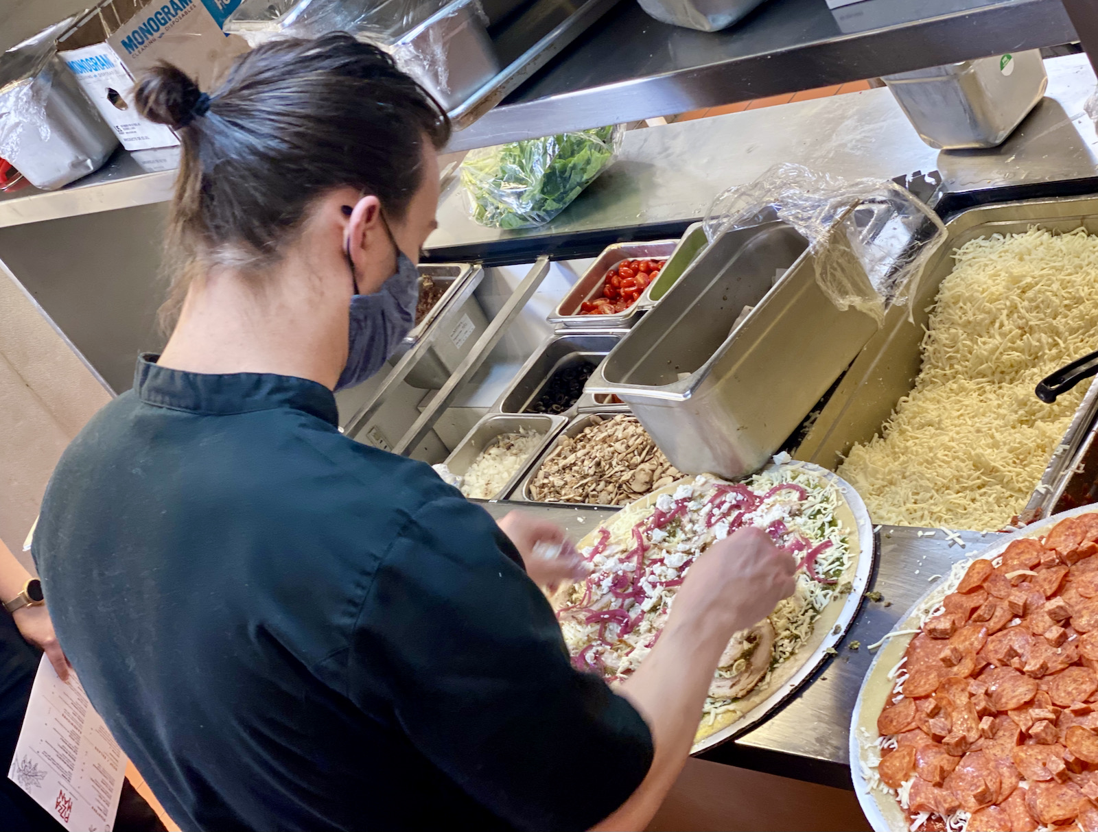 Jesse Wendel making pizzas