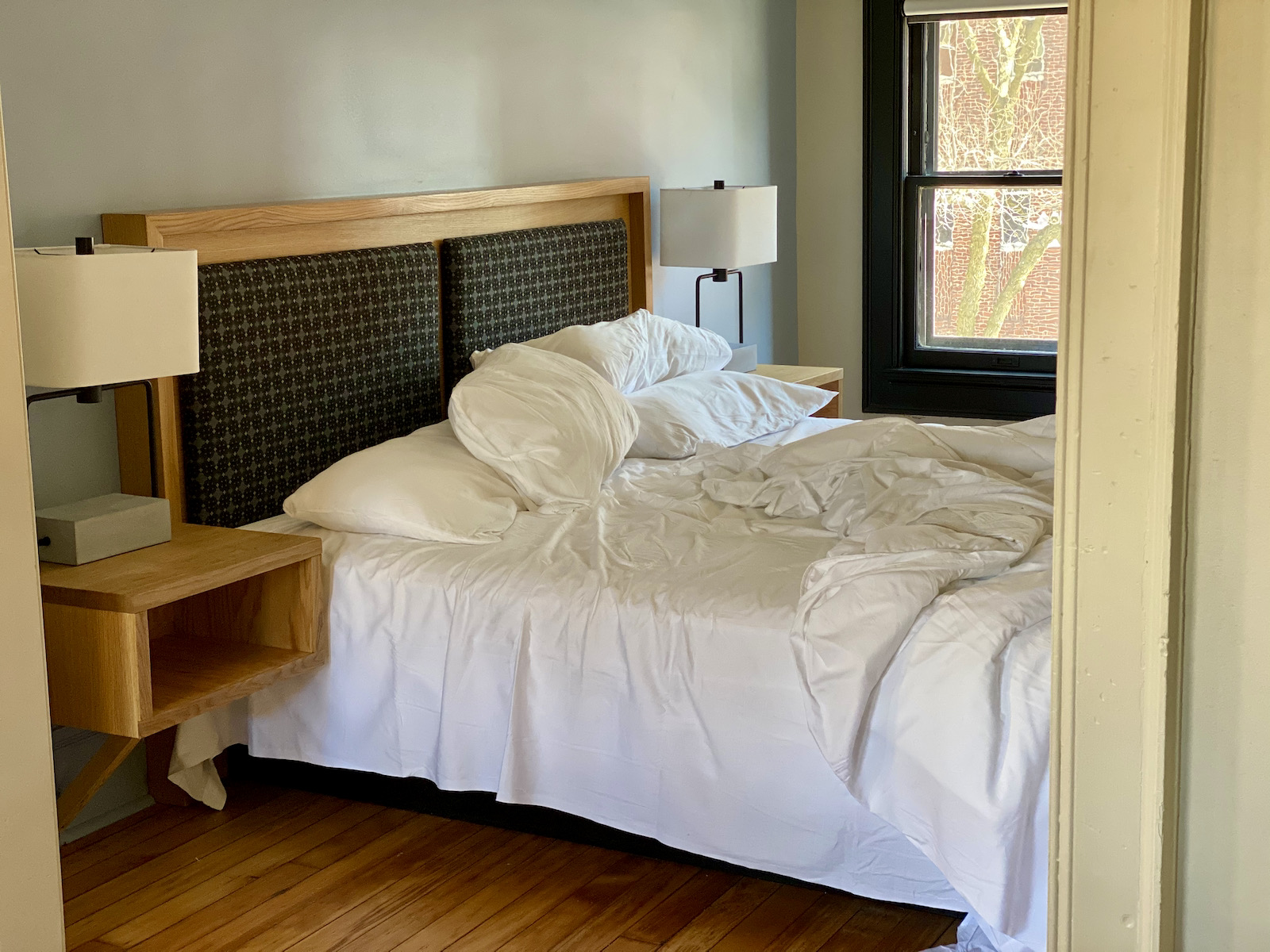 Rumpled hotel bed
