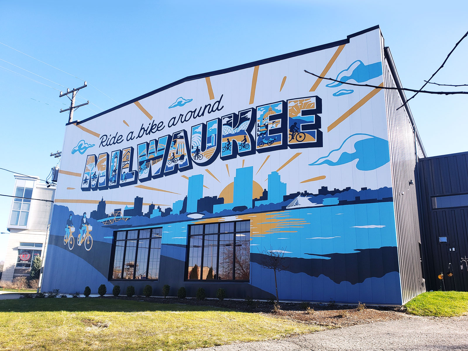 "The new building sits on Robinson Ave., just off of Kinnickinnic Ave. and Becher St. in Bay View. The northern facade displays a massive mural declaring ""Ride a bike around Milwaukee."""