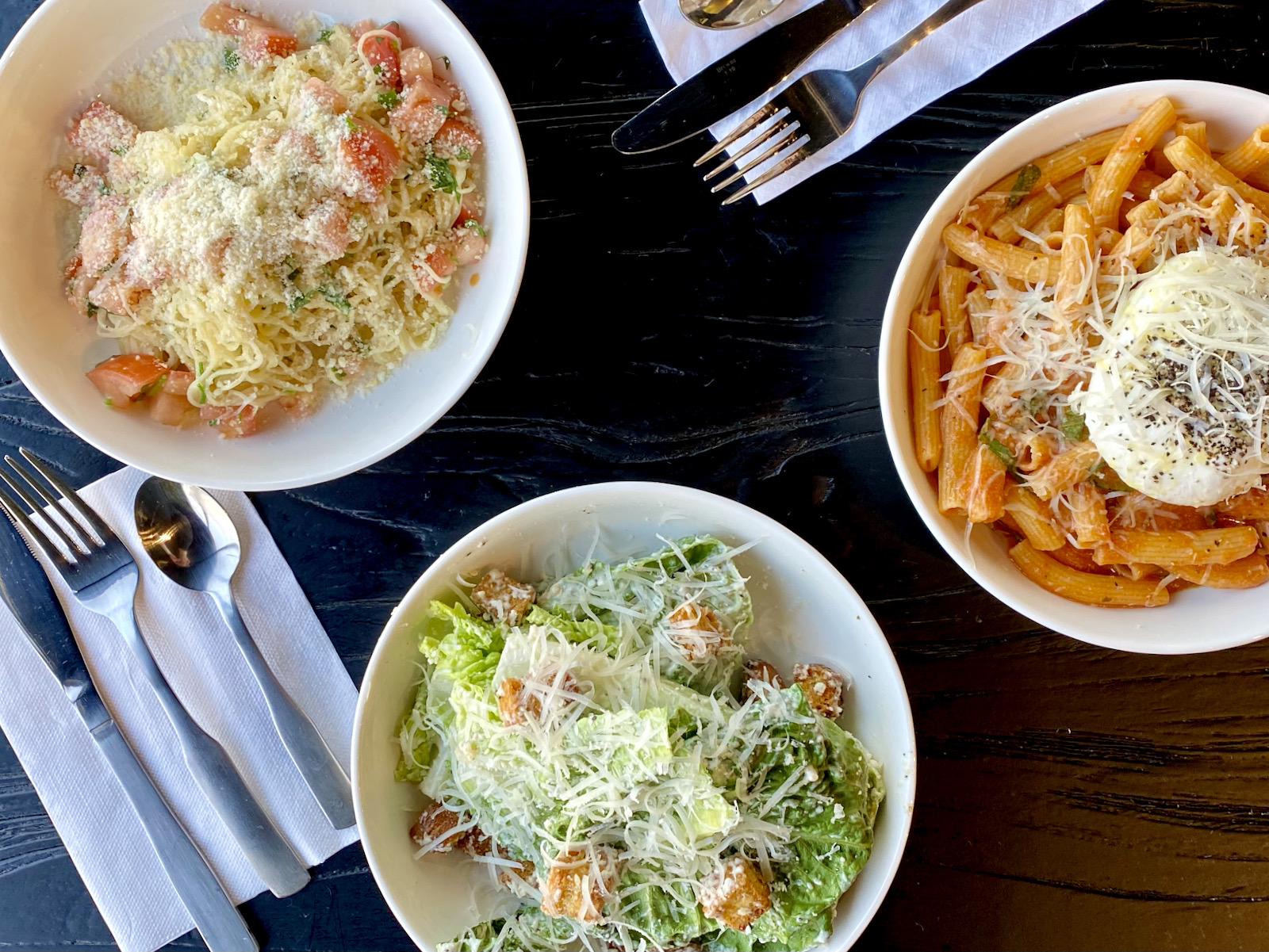 Pasta and salad in bowls