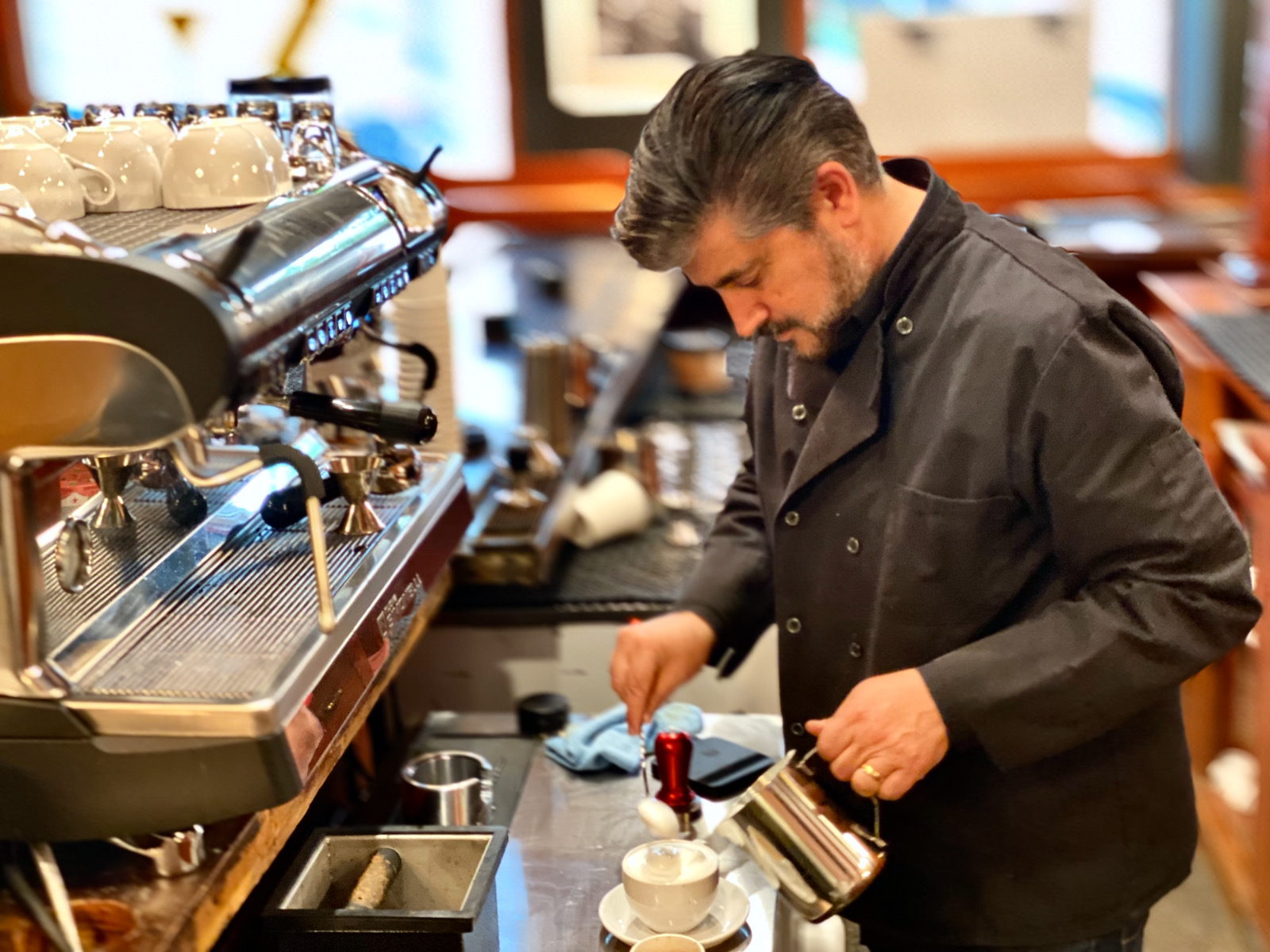 Tommy Orlando making a cappuccino