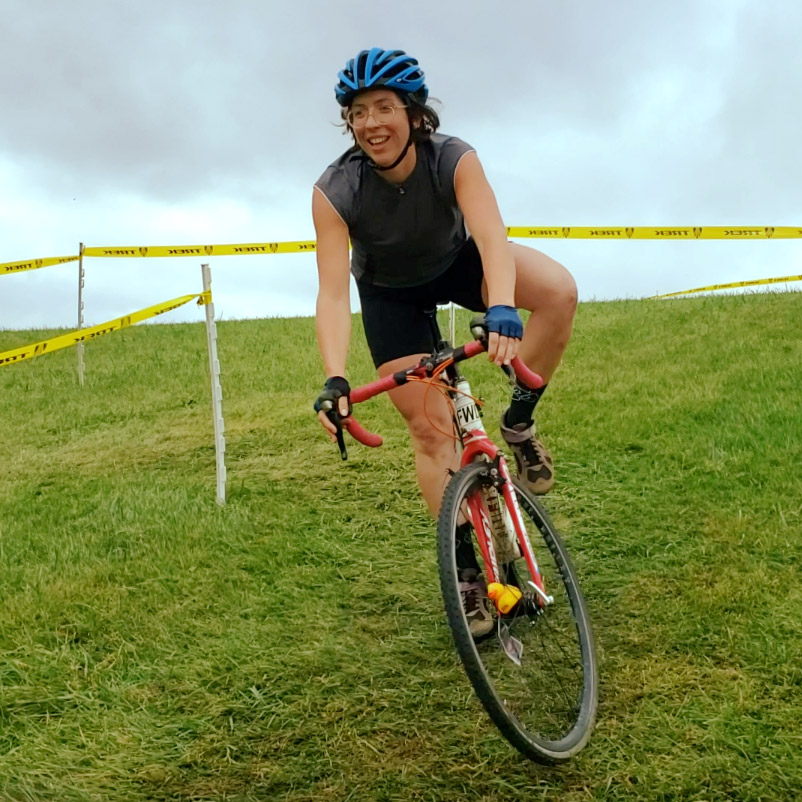 Woman on a cyclocross bike, race on grass in Waterford, WI