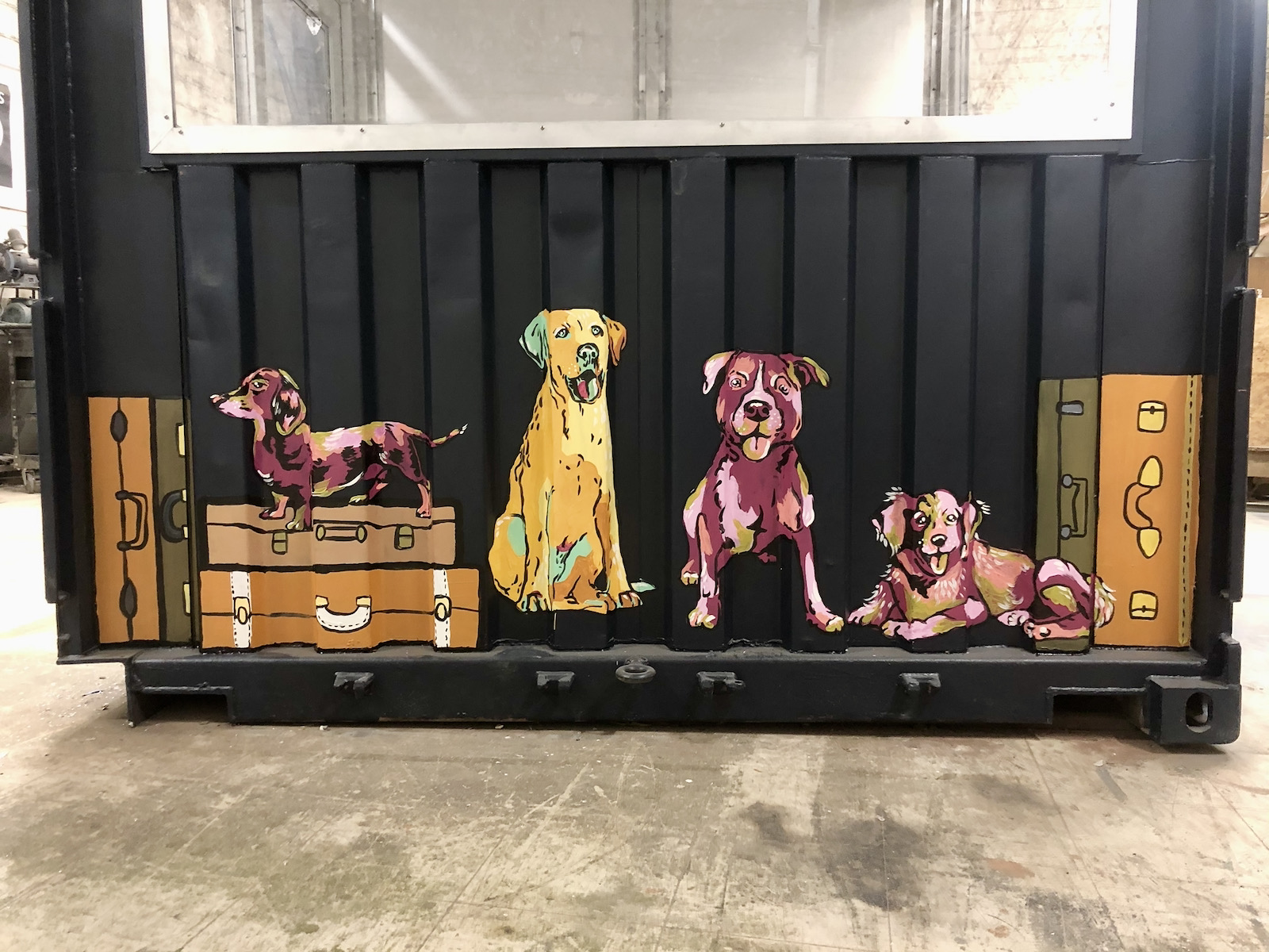Dogs, luggage and beer painted on dining car