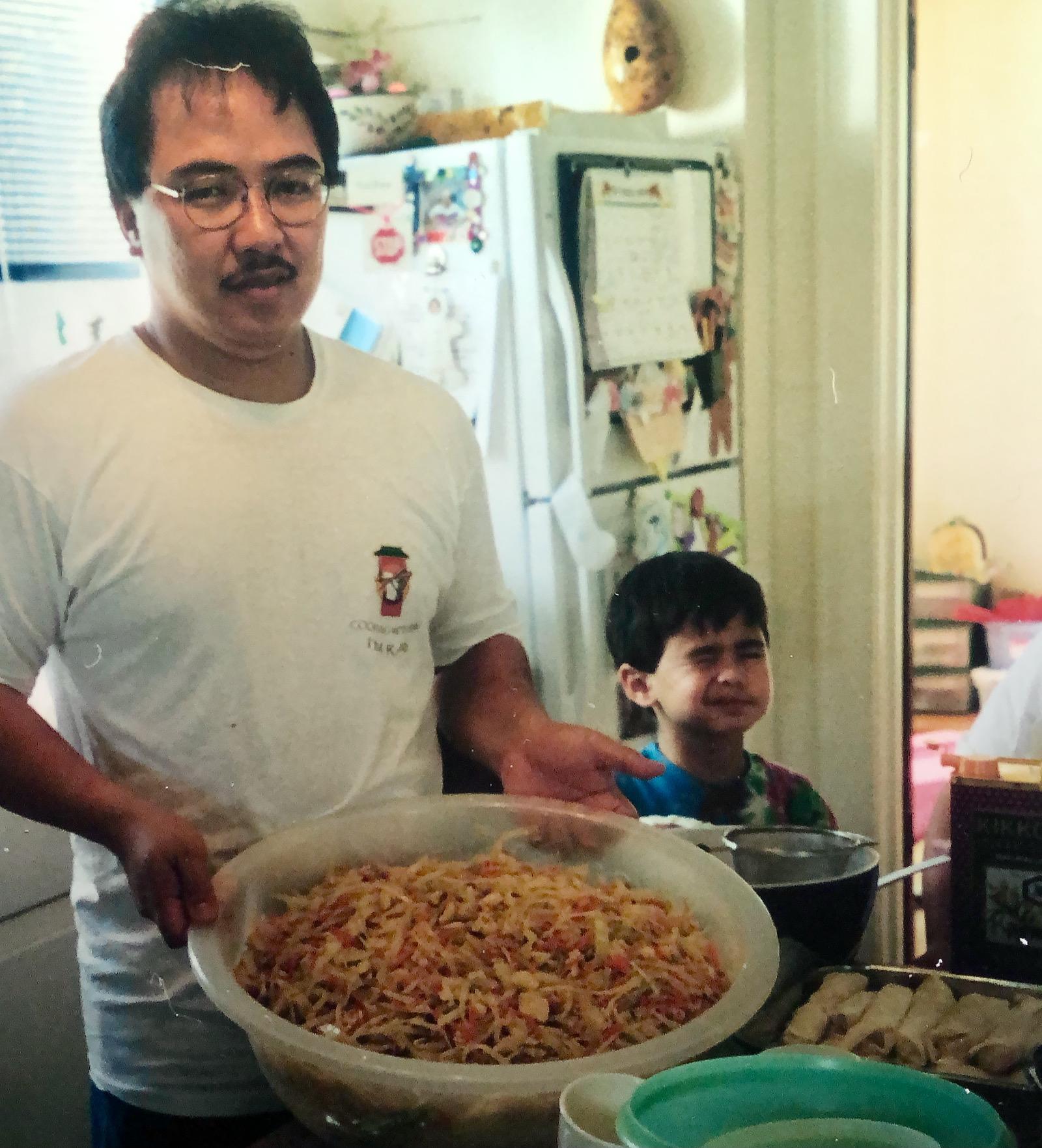 Ray Alfaro and Matthew making pancit and lumpia