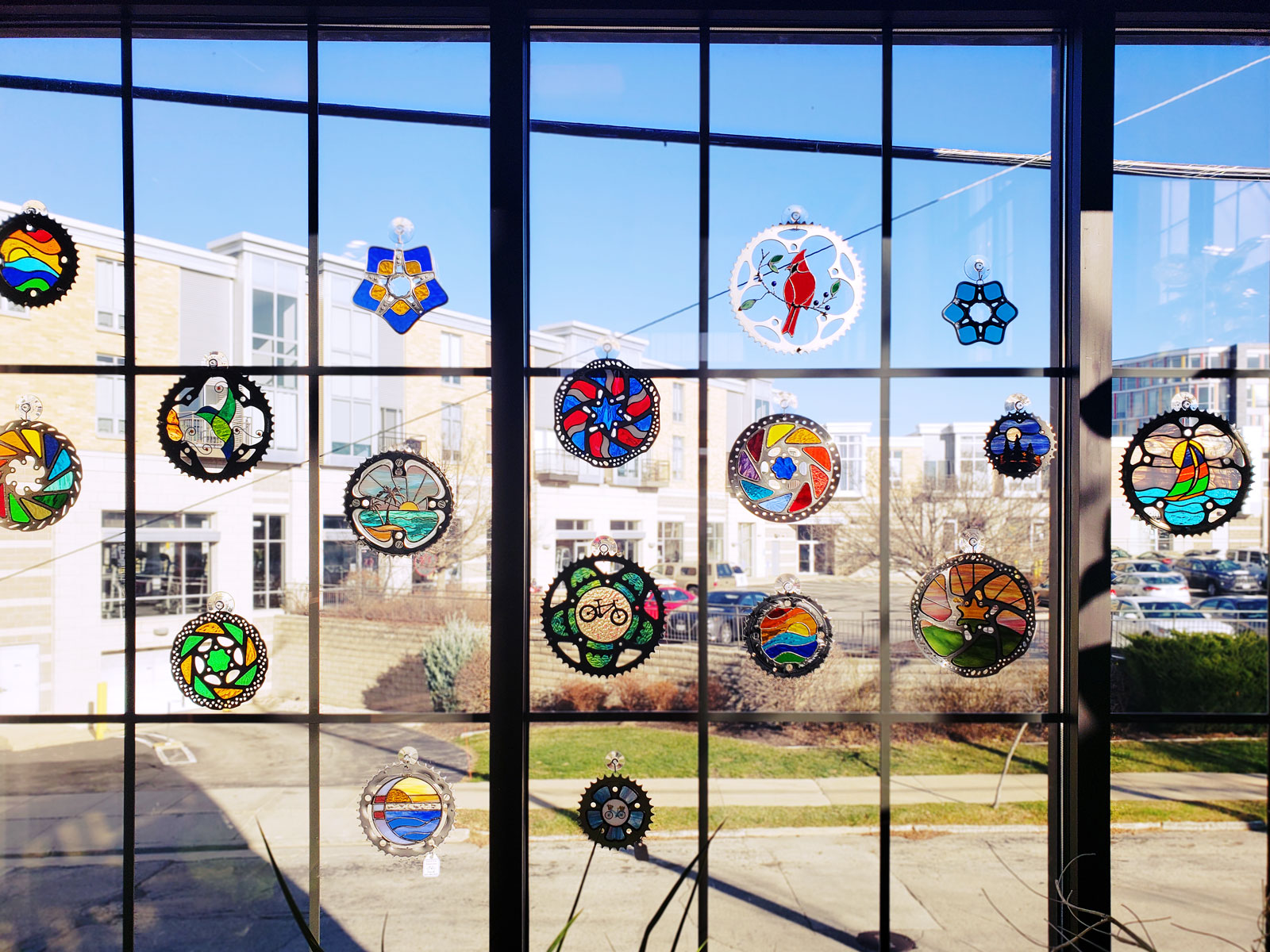 These stained glass window decorations were made from recycled bike parts and will be for sale in the gift shop.