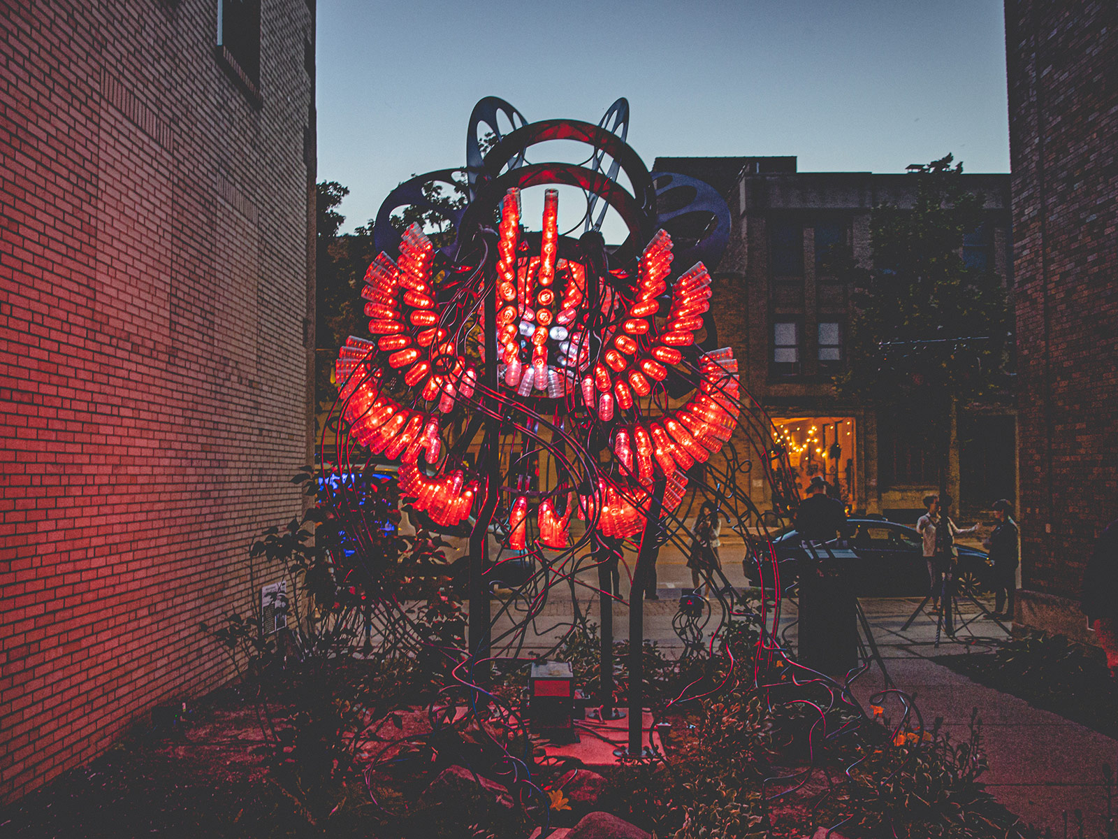 A midwest industrial jellyfish sculpture lit with red LEDs
