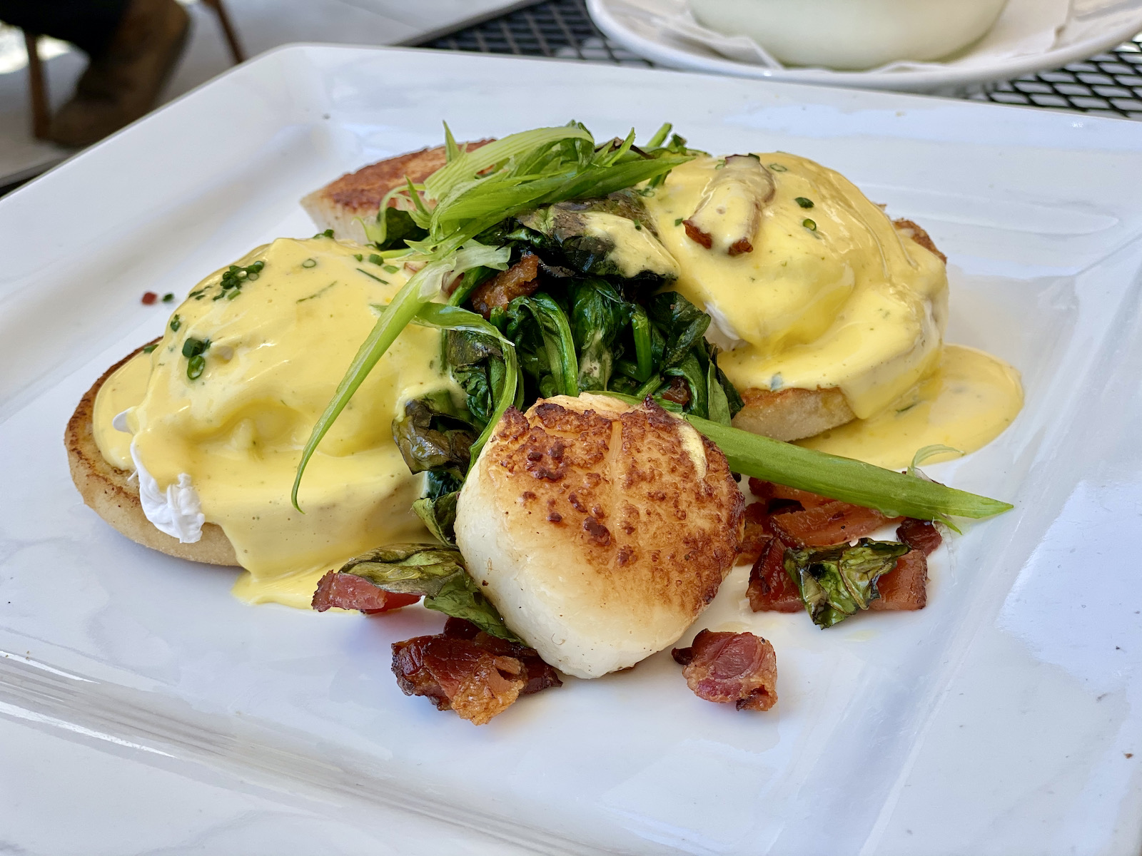 Scallops Benedict with spinach and bacon