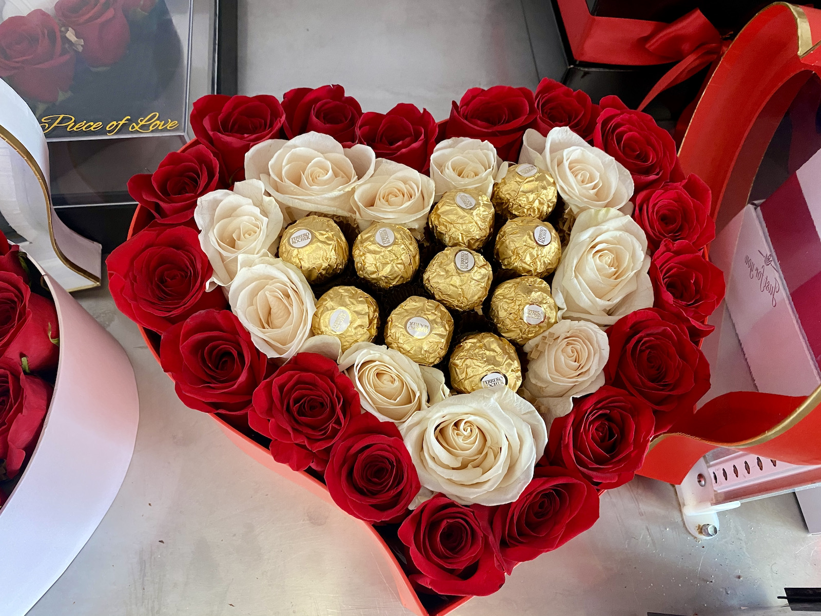 Heart shaped box of candies and roses