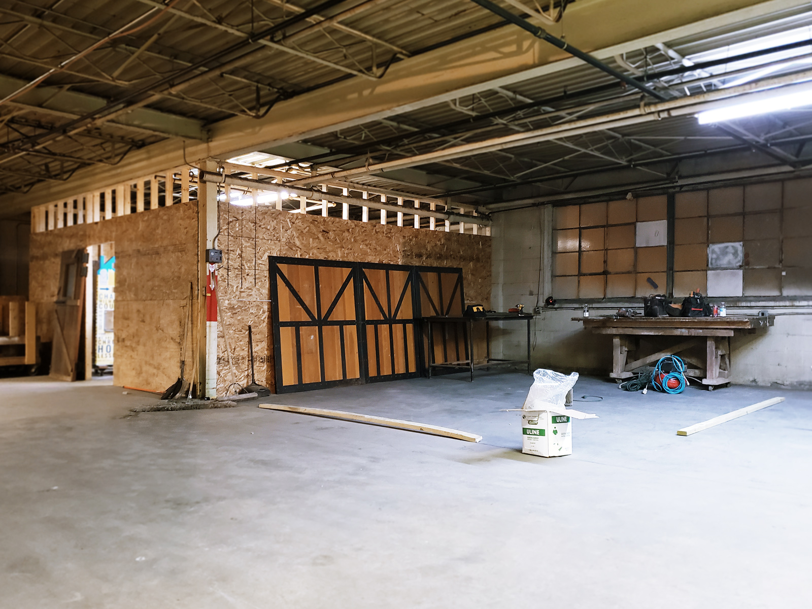 One studio space has been roughed in, while another is deliniated with two-by-fours.