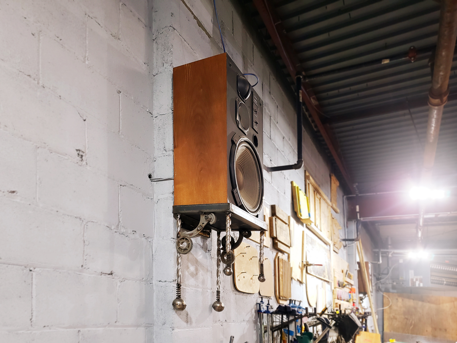 One of the finished speaker shelves, mounted on the shop wall.