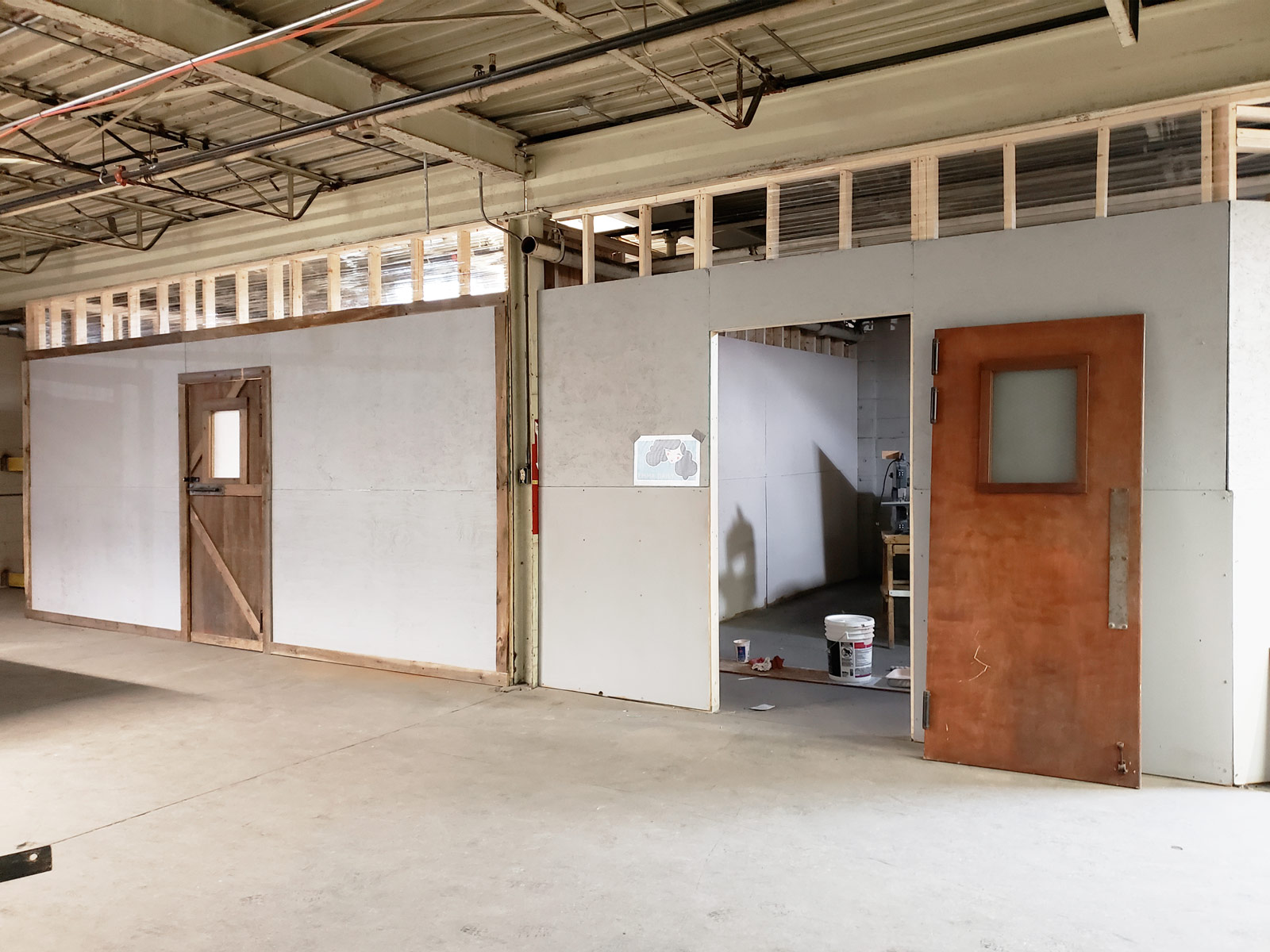 Two drywalled studios, nearing completion