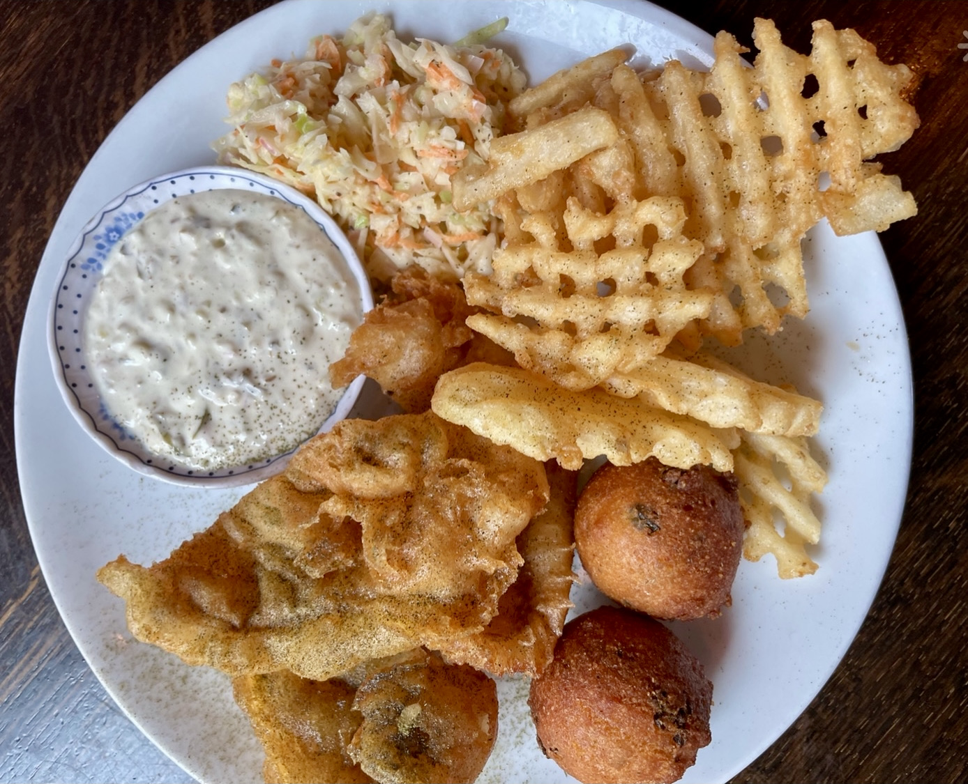 Fish fry with waffle fries, coleslaw, hush puppies
