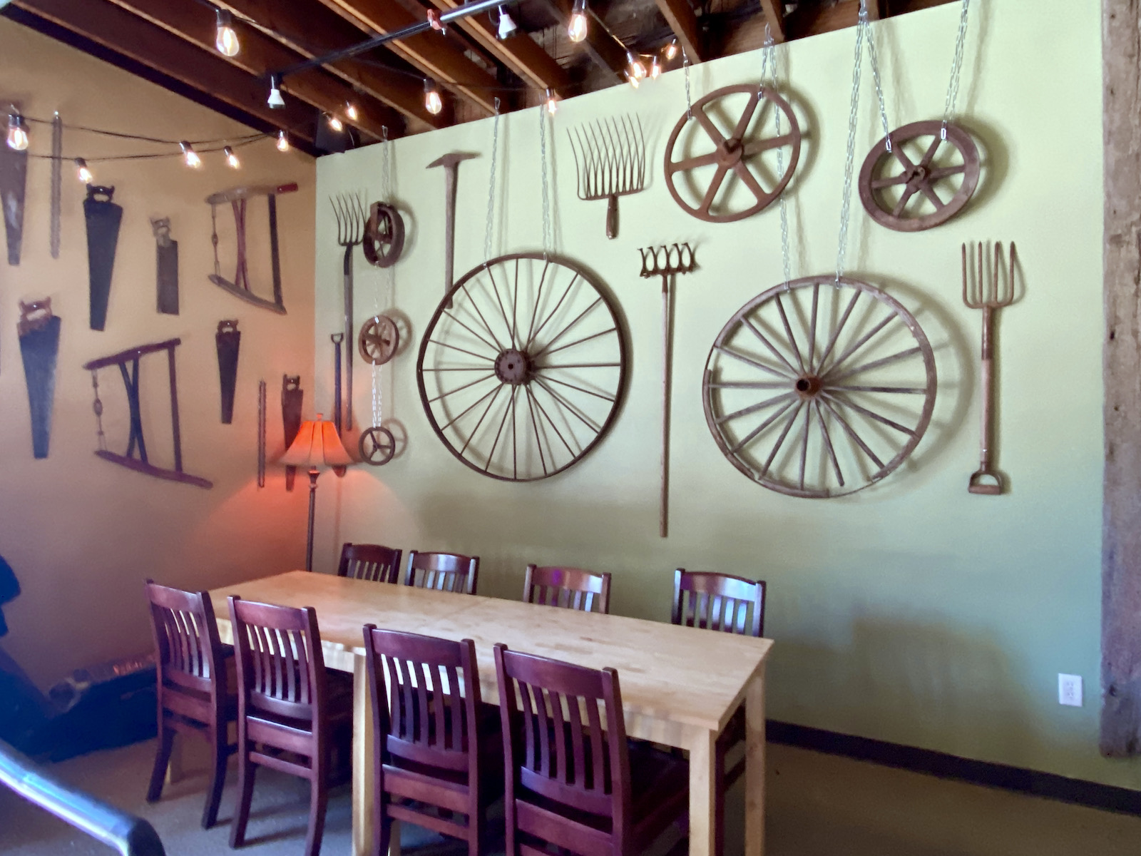 Large group dining table and hand saw wall
