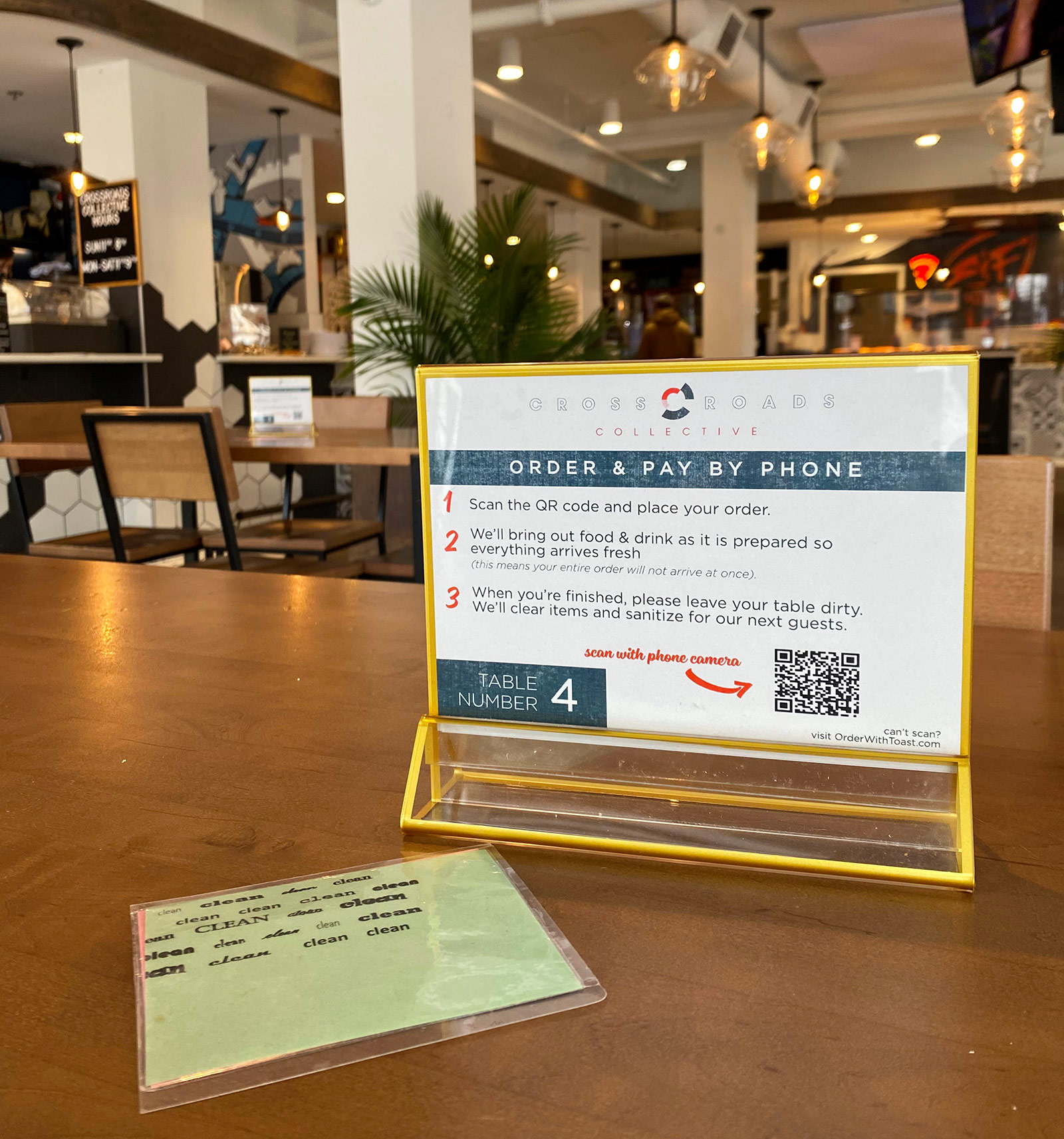 A standee at the Crossroads Collective explains steps to stay safe while eating in public during a pandemic.