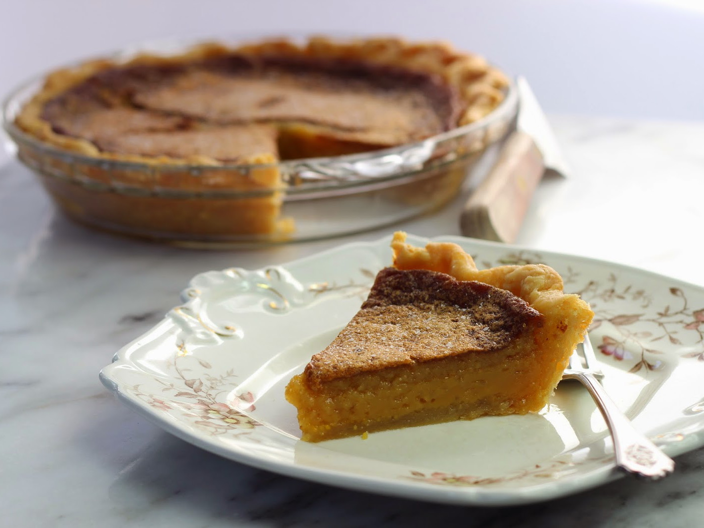 Salted honey pie,  slice and whole pie