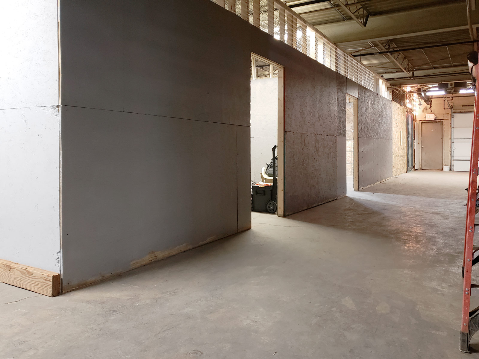 Three loading-dock studios, drywalled and nearing completion