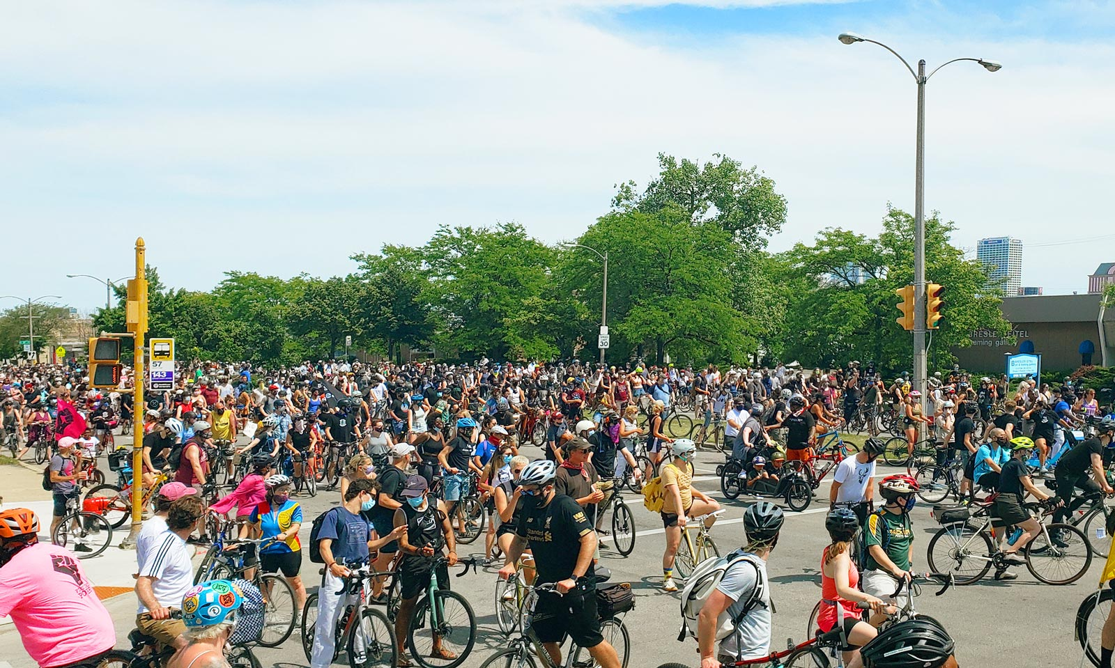A massive group of people on bikes collecting at an intersection during a Black is Beautiful slow roll.