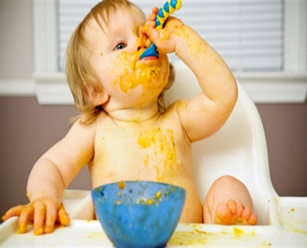 messy-baby-eating-baby-food