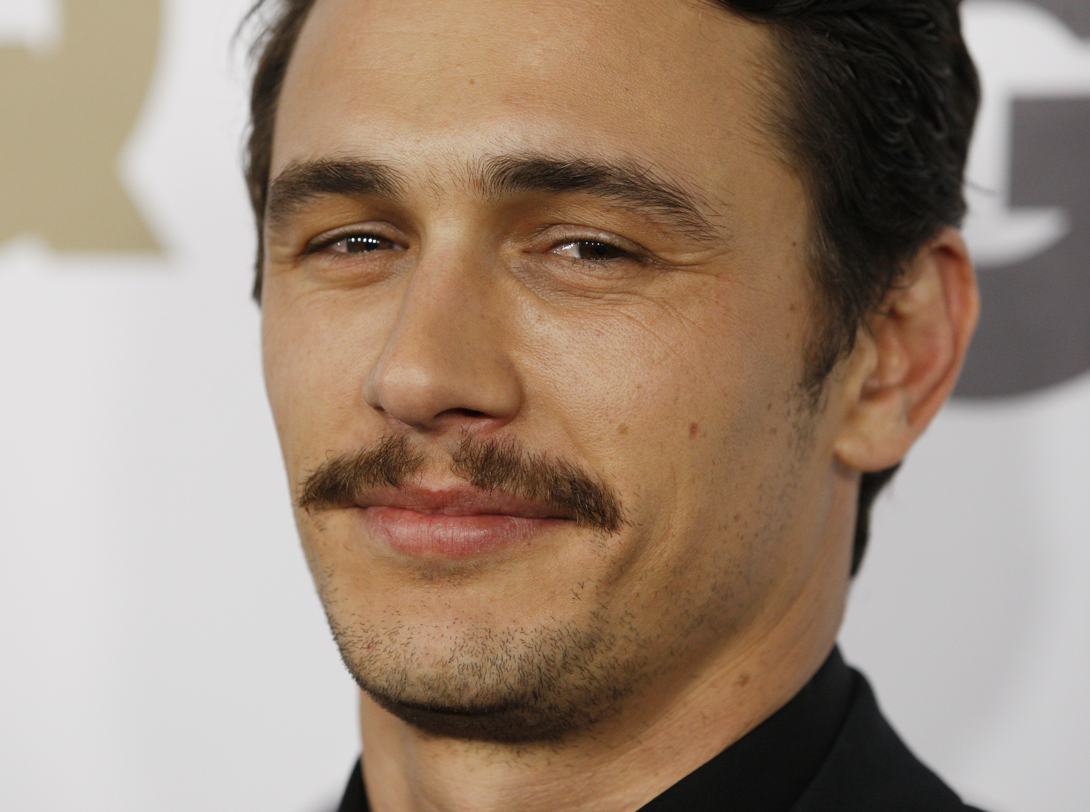 """Actor James Franco arrives at the GQ Magazine 2010 """"Men of the Year"""" party where he was honoured as one of the """"Men of the Year"""" in Hollywood, California, November 17, 2010. REUTERS/Fred Prouser (UNITED STATES - Tags: ENTERTAINMENT)"""