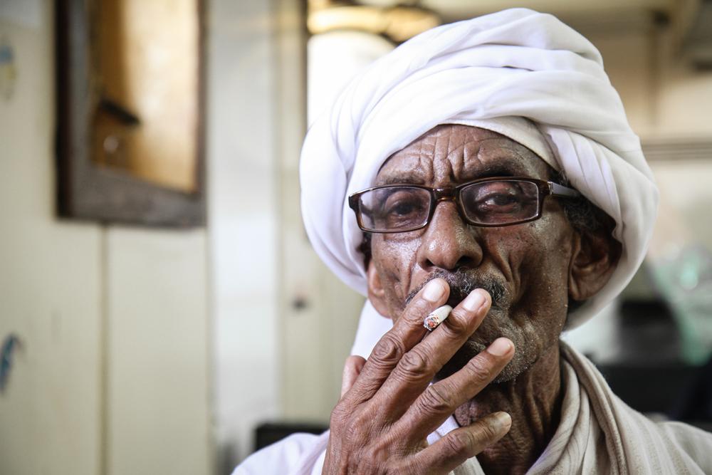 Aswan To Wadi Halfa Ferry Old man Smoking SUDAN