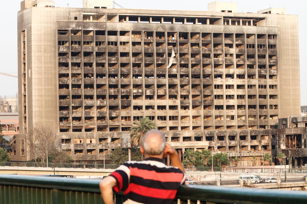 Cairo Burnt Building From Revolution Man Focus EGYPT