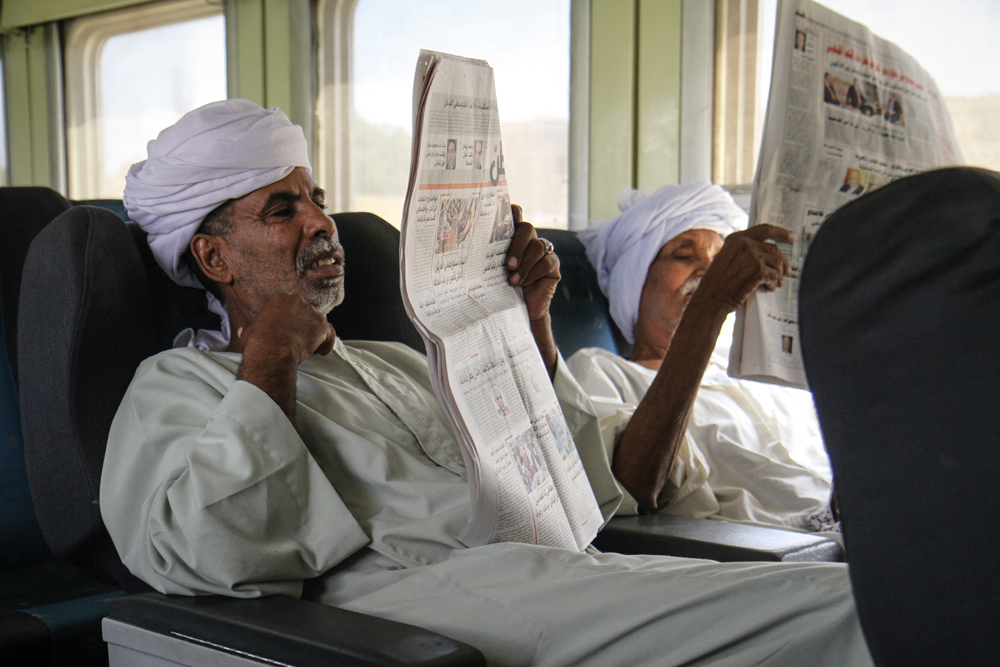 Luxor To Aswan On The Train Men Read Newspapers EGYPT