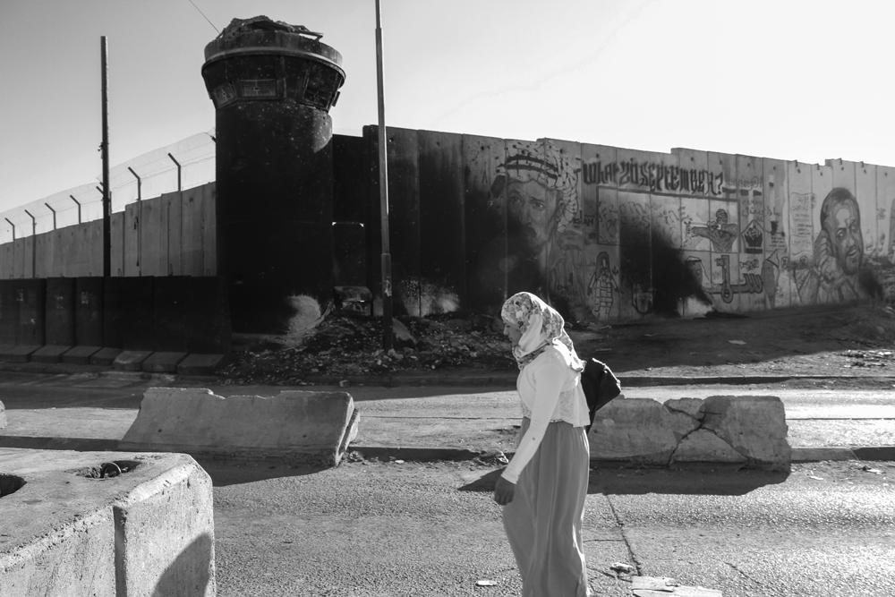 Ramallah Check Point Girl walks Past BlkWht PALESTINE