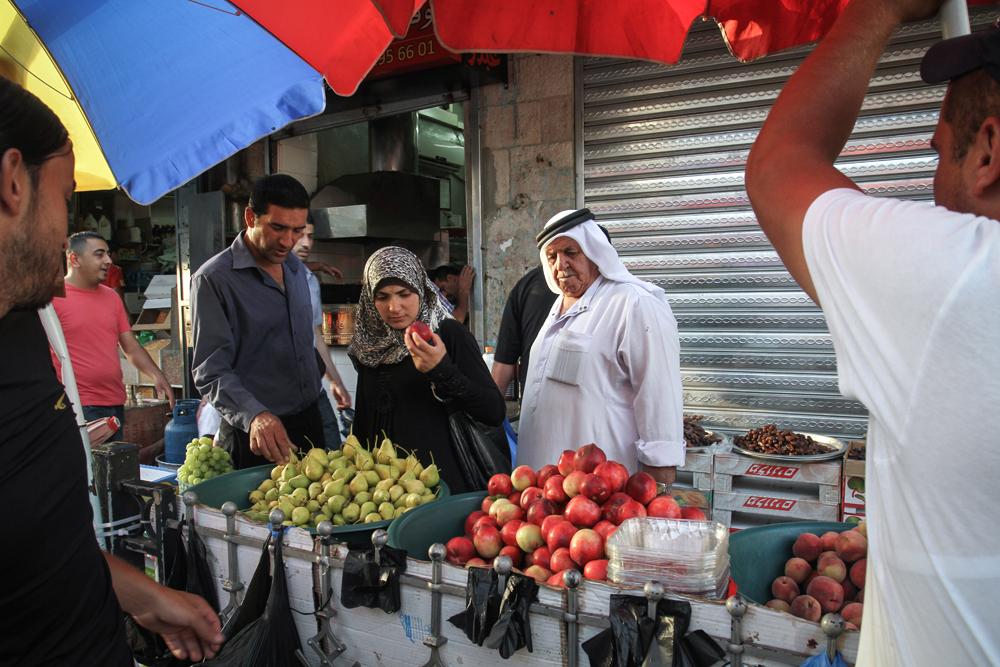 Ramallah Market Looking At Fruit PALESTINE